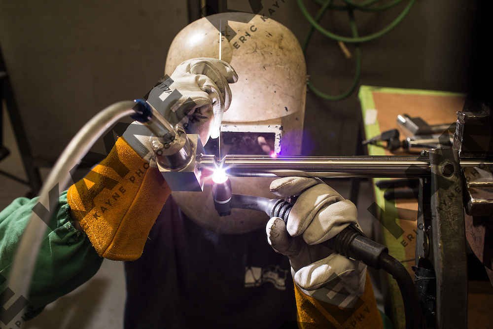 Justin Friend, age 24, who is making $130,000 a year as a welder in Texas, TIG welds Tuesday, Dec. 16, 2014 in Houston.<br /> <br /> CREDIT: Eric Kayne for The Wall Street Journal<br /> <br /> WELDER