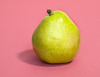 d'anjou pear on a pink background