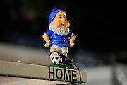 A gnome in Eastleigh colours on top of the home dugout before the The FA Cup match between Eastleigh and Swindon Town at Arena Stadium, Eastleigh, United Kingdom on 4 November 2016. Photo by Graham Hunt.