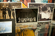 The Display case just outside the Government Documents on the fifth floor of Alden Library showcases artifacts and photographs from Ewing Hall, a building demolished in 1974, on Monday, February 9. The display commemorates Founder's Day, which is February 18.