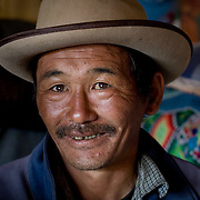 Portrait of middle aged man in hat from Khangil Nuur (Khangil Nuur, Mongolia - Sep. 2008) (Image ID: 080915-0858151a)