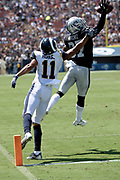 Oakland Raiders cornerback Tevin Mitchel (37) leaps and catches with one hand a pass intended for Los Angeles Rams rookie wide receiver Khadarel Hodge (11) near the end zone pylon, ruled out of bounds and incomplete by officials, during the 2018 NFL preseason week 2 football game against the Los Angeles Rams on Saturday, Aug. 18, 2018 in Los Angeles. The Rams won the game 19-15. (©Paul Anthony Spinelli)
