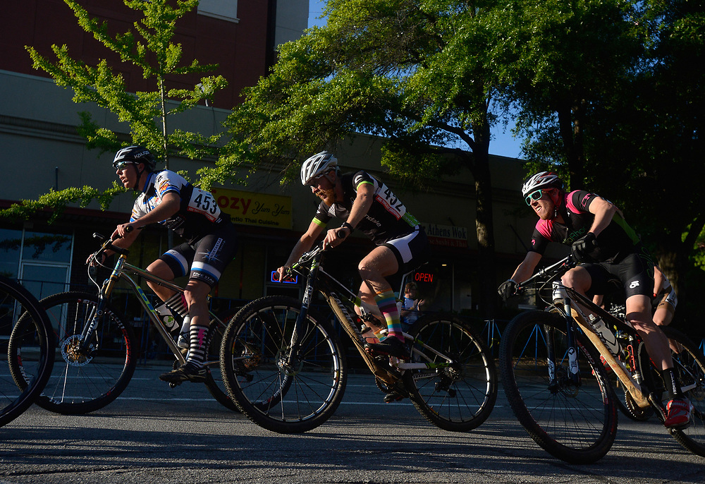 Riders compete in the Scott Mountain Bike Twilight Criterium on Saturday, April 26, 2014 in downtown Athens, Ga.