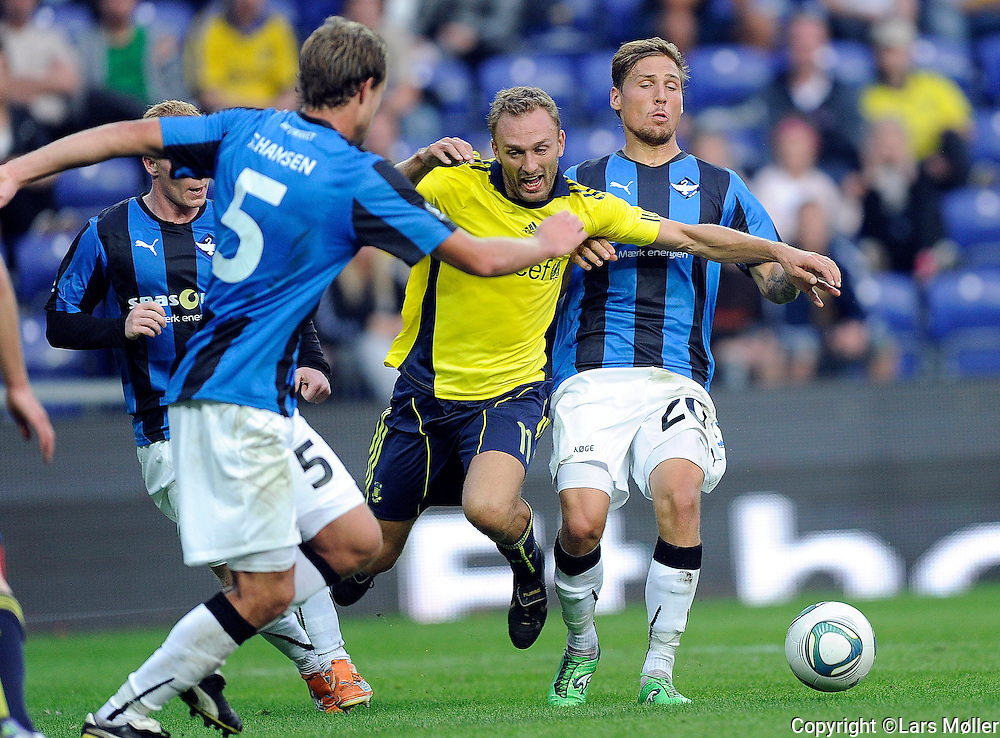 DK Caption:<br /> 20110911, Br&oslash;ndby, Danmark:<br /> Superliga fodbold, Br&oslash;ndby - HB K&oslash;ge:<br /> Dennis Rommedahl, BIF Br&oslash;ndby. , Martin Christensen, HB K&oslash;ge.<br /> Foto: Lars M&oslash;ller<br /> <br /> UK Caption:<br /> 20110911, Brondby, Denmark:<br /> Superleague football  Brondby - HB K&oslash;ge:<br /> Dennis Rommedahl, BIF Br&oslash;ndby. , Martin Christensen, HB K&oslash;ge.<br /> Photo: Lars Moeller