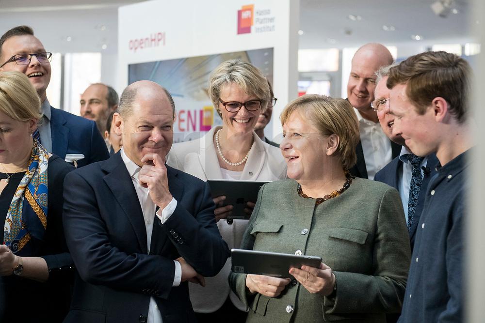 14 NOV 2018, POTSDAM/GERMANY:<br /> Olaf Scholz (L), SPD, Bundesfinanzminister, Anja Karliczek (M), MdB, CDU, Bundesministerin fuer Bildung und Forschung, Angela Merkel (R), CDU, Bundeskanzlerin, mit einem iPad, waehrend einer Praesentation des HPI im Rahmen der Klausurtagung des Bundeskabinetts, Hasso Plattner Institut (HPI), Potsdam-Babelsberg<br /> IMAGE: 20181114-01-095<br /> KEYWORDS; Kabinett, Klausur, Tagung, freundlich, fröhlich, froehlich