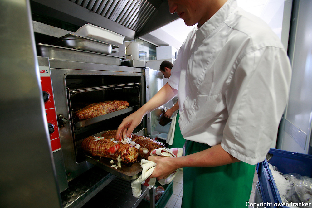 Restaurant Bras, Laguiole, in the Aubrac region, France..Preparation and eating of the staff meal - the roast pork