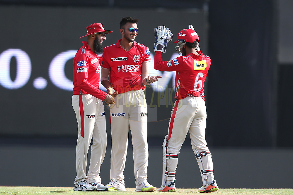 Hashim Amla of Kings XI Punjab and Wriddhiman Saha of Kings XI Punjab congratulates Akshar Patel of Kings XI Punjab for getting Chris Morris of the Delhi Daredevils wicket during match 36 of the Vivo 2017 Indian Premier League between the Kings XI Punjab and the Delhi Daredevils held at the Punjab Cricket Association IS Bindra Stadium in Mohali, India on the 30th April 2017<br /> <br /> Photo by Shaun Roy - Sportzpics - IPL