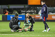 Forest Green Rovers Jack Fitzwater(16) is treated by Forest Green Rovers physio Joe Baker during the EFL Sky Bet League 2 match between Forest Green Rovers and Cheltenham Town at the New Lawn, Forest Green, United Kingdom on 25 November 2017. Photo by Shane Healey.