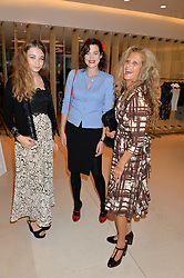 Left to right, MATILDA WYMAN, JASMINE GUINNESS and SUZANNE WYMAN at the launch of the 'Jasmine for Jaeger' fashion collection by Jasmine Guinness for fashion label Jaeger held at Fenwick's, Bond Street, London on 9th September 2015.