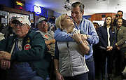 U.S. Republican presidential candidate Ted Cruz embraces his wife Heidi during a campaign event in Ringsted, Iowa, United States, January 29, 2016.   REUTERS/Jim Young