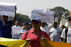 March 26, 2019 - Valencia, Carabobo, Venezuela - March 26, 2019. Commemorating the 61 years of reopening of the University of Carabobo, UC, ushers protested against Nicolas Maduro for worsening the working conditions of administrative staff, workers, teachers and directors of the UC, apart from the direct involvement with the new general shutdown in the country that leads to the suspension of classes. the protesters decided to end the activity with the burning of a monigote of Nicolas Maduro, whom they consider usurping the post of president of the republic of Venezuela. The protest was held in the city of Valencia, carabobo state. Photo: Juan Carlos Hernandez (Credit Image: © Juan Carlos Hernandez/ZUMA Wire)