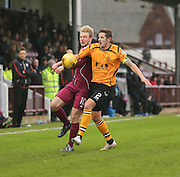 Arbroath's Josh Skelly challenges for the ball with Annan's Steven Black - Arbroath v Annan Athletic, Ladbrokes SPFL League two at Gayfield<br /> <br />  - &copy; David Young - www.davidyoungphoto.co.uk - email: davidyoungphoto@gmail.com