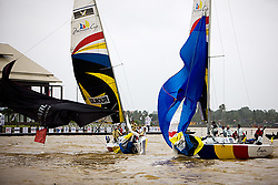 "Peter Gilmour and Sebastien Col during the finish on the last race of their quarter final. Gilmours spinnaker is flogging but passes the line first. The race officer saw it different and had Col winning the match. According to the empire call Gilmours spinnaker was in its ""normal"" position during the finish which gives him the win over Col. Gilmour beats Col 3-2. The photo was taken form the start boat. (Saturday the 6th December 2008)."