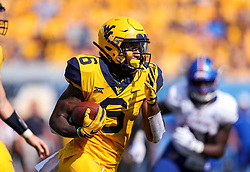 Oct 6, 2018; Morgantown, WV, USA; West Virginia Mountaineers running back Kennedy McKoy (6) runs the ball during the fourth quarter against the Kansas Jayhawks at Mountaineer Field at Milan Puskar Stadium. Mandatory Credit: Ben Queen-USA TODAY Sports