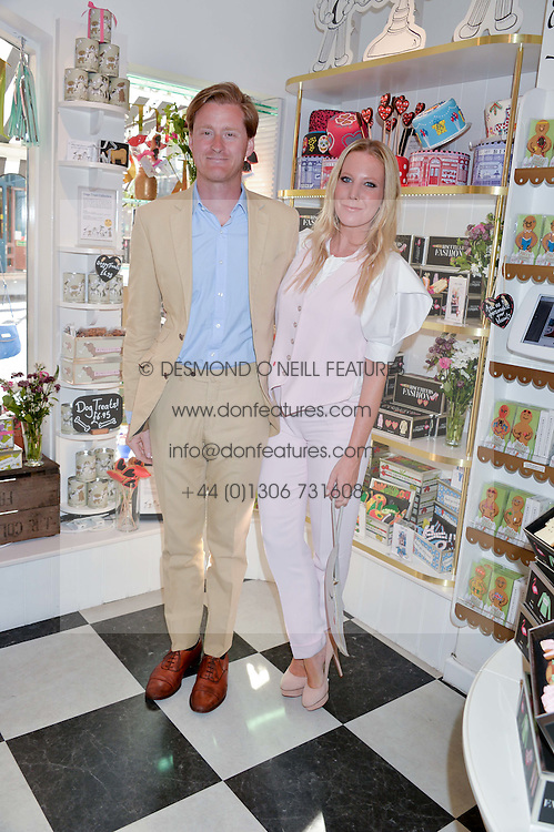 TOM & ALICE NAYLOR-LEYLAND at a party to launch Biscuiteers Fashion Biscuit Collection inspired by Alice Naylor-Leyland's wardrobe held at Biscuiteers, 194 Kensington Park Road, London W11 on 23rd June 2015.