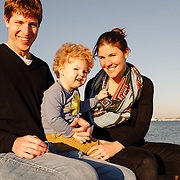 Adam, Jesse, and little Noah Pomerantz family portrait session at Charleston, South Carolina's downtown Waterfront Park