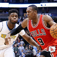 22 November 2016: Chicago Bulls guard Rajon Rondo (9) drives past Denver Nuggets guard Emmanuel Mudiay (0) during the Denver Nuggets 110-107 victory over the Chicago Bulls, at the Pepsi Center, Denver, Colorado, USA.
