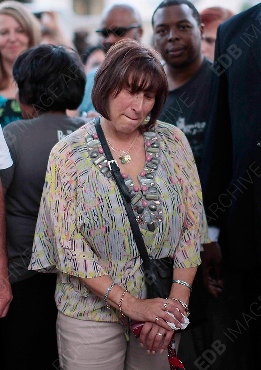 23.JULY.2012. LONDON<br /> <br /> MITCH WINEHOUSE AND WIFE JANE AND EX-WIFE JANIS AT LATE SINGER AMY WINEHOUSE'S CAMDEN HOME FOR A MEMORIAL SERVICE AND GET EMOTIONAL AT READING ALL THE TRIBUTES OUTSIDE.<br /> <br /> BYLINE: EDBIMAGEARCHIVE.CO.UK<br /> <br /> *THIS IMAGE IS STRICTLY FOR UK NEWSPAPERS AND MAGAZINES ONLY*<br /> *FOR WORLD WIDE SALES AND WEB USE PLEASE CONTACT EDBIMAGEARCHIVE - 0208 954 5968*