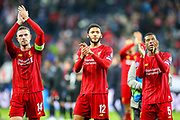 Liverpool players Liverpool midfielder Jordan Henderson (14) Liverpool defender Joe Gomez (12) and Liverpool midfielder Georginio Wijnaldum (5) thank fans at full time during the Champions League match between FC Red Bull Salzburg and Liverpool at the Red Bull Arena, Salzburg, Austria on 10 December 2019.