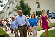 Grinnell College President Raynard Kington, left, walks alongside Rachel Bly and Wellness Coordinator Jen Jacobsen during the 1K loop around Grinnell's campus as a part of the Healthiest State Initiative Start Somewhere Walk..