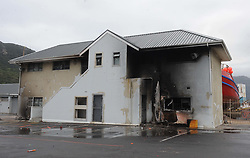 Cape Town - 180813 - The Hout Bay fishing community are distraught and tensions are running high after an alleged poacher was shot at see while being apprehended by the authorities In pic is a damaged government office on the harbour -  Photographer - Tracey Adams - ANA African News Agency