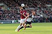 Adam Rooney (9) heads wide during the EFL Sky Bet League 2 match between Northampton Town and Salford City at the PTS Academy Stadium, Northampton, England on 19 October 2019.