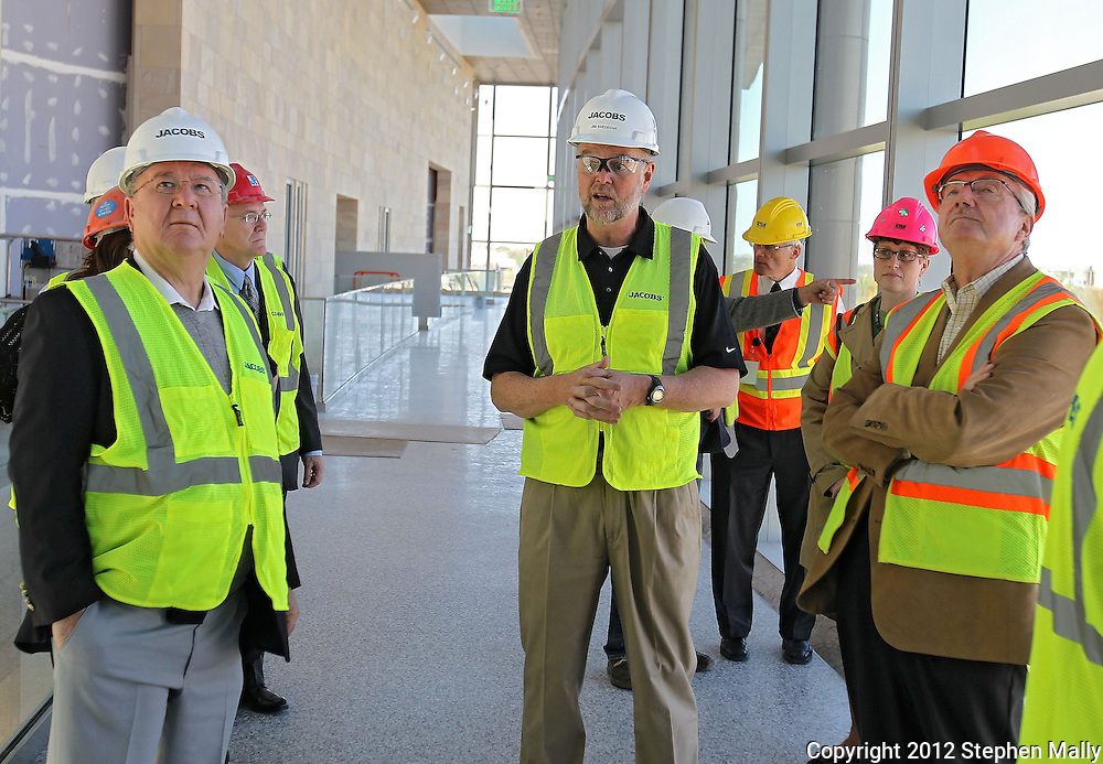 City Council members Justin Shields (left) and Scott Olson (right) listen as GSA project Manager Jim Snedegar (center) talks about construction during a tour of the new Federal Courthouse in Cedar Rapids on Tuesday morning, April 10, 2012. (Stephen Mally/Freelance)