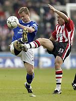 Photo. Aidan Ellis.<br /> Southampton v Everton.<br /> FA Barclaycard Premiership.<br /> 21/02/2004.<br /> Southampton's Paul Telfer and Everton's Tobias Linderoth