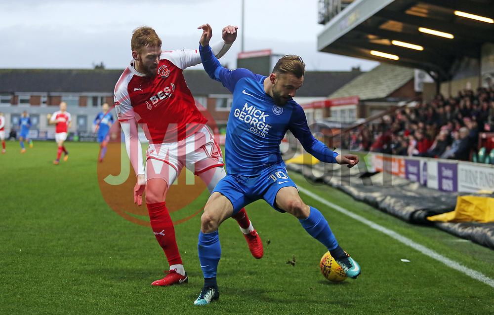 Danny Lloyd of Peterborough United battles for the ball with Cian Bolger of Fleetwood Town - Mandatory by-line: Joe Dent/JMP - 17/12/2017 - FOOTBALL - Highbury Stadium - Fleetwood, England - Fleetwood Town v Peterborough United - Sky Bet League One