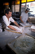 SAFRANBOLU, TURKEY AUGUST 2003. Workers prepare the mix for Turkish Delight at the Safrantat factory. The city of Safranbolu positioned in the forests on the Black Sea coast is one of the world heritage sites of the UNESCO. Apart from its Ottoman era wood and mudbrick houses it is also known for its 'Lokum' or Turkish delight. A delicate sweets with flavours from nuts to rose petals. Photo by Frits Meyst/Adventure4ever.com