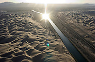 The All-American Canal runs through the Imperial Sand Dunes west of Yuma on its way to the Imperial Valley.