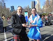 Donnie Jack, left, Scottish Affairs Counsellor for the Americas, presents Megan Hogan, of New York, with a traditional Scottish friendship cup after she is the first female finisher of the 12th annual Scotland Run in New York's Central Park, Saturday, April 4, 2015, as part of Scotland Week.  (Photo by Diane Bondareff/Invision for Scotland Week/AP Images)