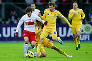 (L) Grzegorz Krychowiak of Poland fights for the ball with (C) Denys Harmasz and (R) Ruslan Rotan both of Ukraine during the 2014 World Cup Qualifying Group H soccer match between Poland and Ukraine at National Stadium in Warsaw on March 22, 2013...Poland, Warsaw, March 22, 2013...Picture also available in RAW (NEF) or TIFF format on special request...For editorial use only. Any commercial or promotional use requires permission...Photo by © Adam Nurkiewicz / Mediasport