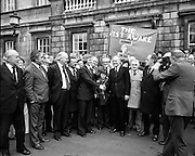 Newly Elected TD Enda Kenny Arrives at The Dail..(J89)..1975..18.11.1975..11.18.1975..18th November 1975..Following the death of his father,Henry Kenny TD, Enda Kenny was proposed by the Fine Gael party to contest the seat. He was duly elected and went to Dublin to take up his seat in Dail Eireann at Leinster House, Dublin..Image of Enda Kenny  and An Taoiseach, Liam Cosgrave, surrounded by supporters, many of whom had travelled by bus from Mayo to attend Endas' first day as a T.D.