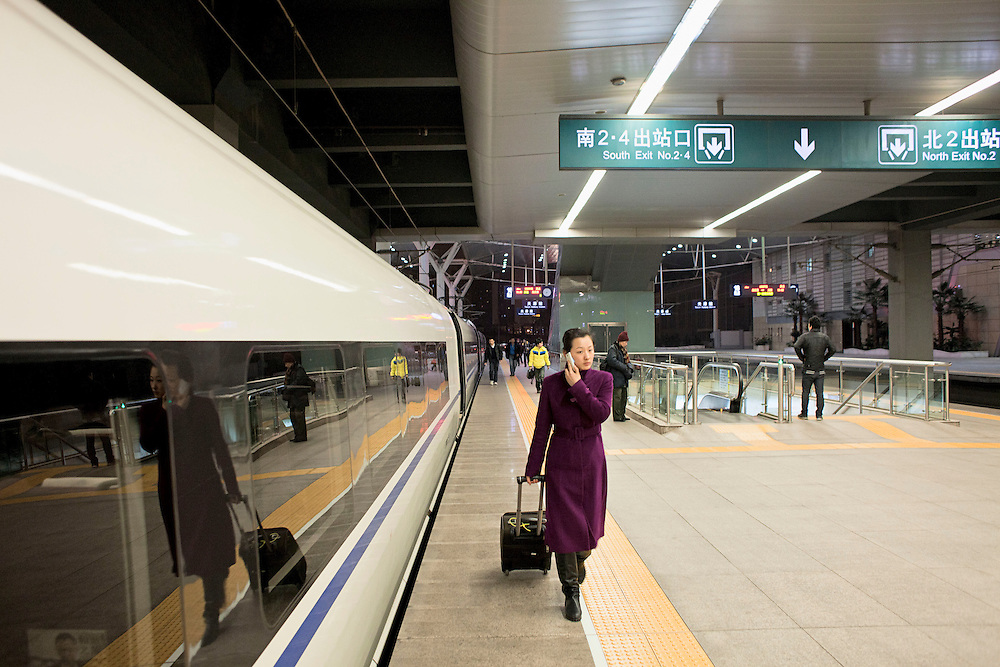 Train attendant at Beijing South Railway Station. Beijing, China. 2012