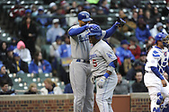 CHICAGO - APRIL  22:  Juan Uribe #5 is greeted by Matt Kemp #27 of the Los Angeles Dodgers after Uribe hit a home run against the Chicago Cubs on April 22, 2011 at Wrigley Field in Chicago, Illinois.  The Dodgers defeated the Cubs 12-2.  (Photo by Ron Vesely)  Subject:  Juan Uribe;Matt Kemp