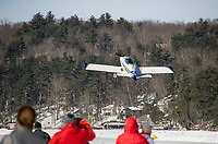 A plane takes off from the runway on Lake Winnipesaukee in Alton Bay during Winter Carnival on Sunday.   (Karen Bobotas/for the Laconia Daily Sun)