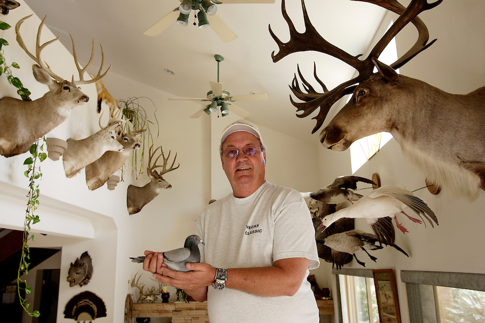 Ed Sittner With Hunting Trophies On Wall