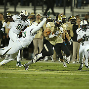 UCF Knights wide receiver J.J. Worton (9) runs past South Florida Bulls linebacker Hans Louis (50) during an NCAA football game between the South Florida Bulls and the 17th ranked University of Central Florida Knights at Bright House Networks Stadium on Friday, November 29, 2013 in Orlando, Florida. (AP Photo/Alex Menendez)