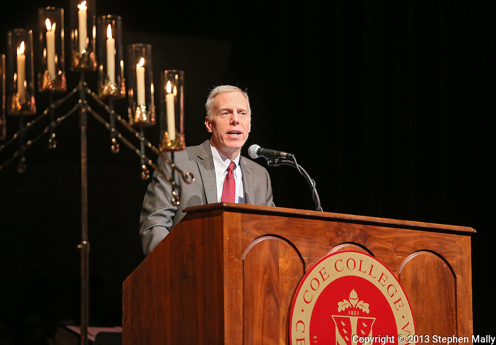 Coe College President David McInally reads John 1:1-14 for the seventh lesson of the Coe College Christmas Convocation at Sinclair Auditorium in Cedar Rapids on December 3, 2013. The convocation included songs by the Coe College Chorale, Concert Choir, and Handbell Ensemble, along with readings from the Bible.