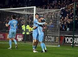 Coventry City players Tom Bayliss and Dion Kelly-Evans celebrate after the final whistle of the Emirates FA Cup  Fourth Round match at  Stadium MK Milton Keynes.