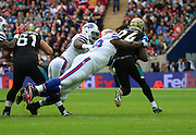 Buffalo Bills Marquise Goodwin tackling Jacksonville Jaguars T.J. Yeldon during the Buffalo Bills v Jacksonville Jaguars NFL International Series match at Wembley Stadium, London, England on 25 October 2015. Photo by Matthew Redman.