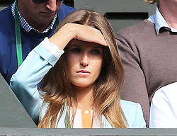 Kim Sears watching Andy Murray play his first game on  Centre Court on the opening day of Wimbledon 2013<br /> London, Monday, 24th June 2013<br /> Picture by Stephen Lock / i-Images