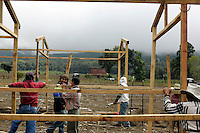 Residents and other workers construct buildings to house residents displaced by mudslides that occured earlier in the month when torrential rains associated with Hurricane Stan inundated parts of Central America. About 25 homes and several fields of crops  in Tzanchaj were lost in the mudslide. The workers will build enough housing and common work, cooking and cleaning areas for 300 families.