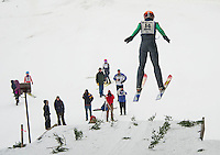 Cameron Summerton U14 from Lebanon Outing Club takes off from the K20 jump during Gunstock Nordic Associations ski jump meet held on Saturday morning.  (Karen Bobotas/for the Laconia Daily Sun)