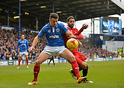 Portsmouth defender Enda Stevens holds off Leyton Orient Midfielder Jobi McAnuff during the Sky Bet League 2 match between Portsmouth and Leyton Orient at Fratton Park, Portsmouth, England on 6 February 2016. Photo by Adam Rivers.