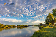 Sunrise clouds over the Powder River near the confluence with the Yellowstone River near Terry, Montana, USA