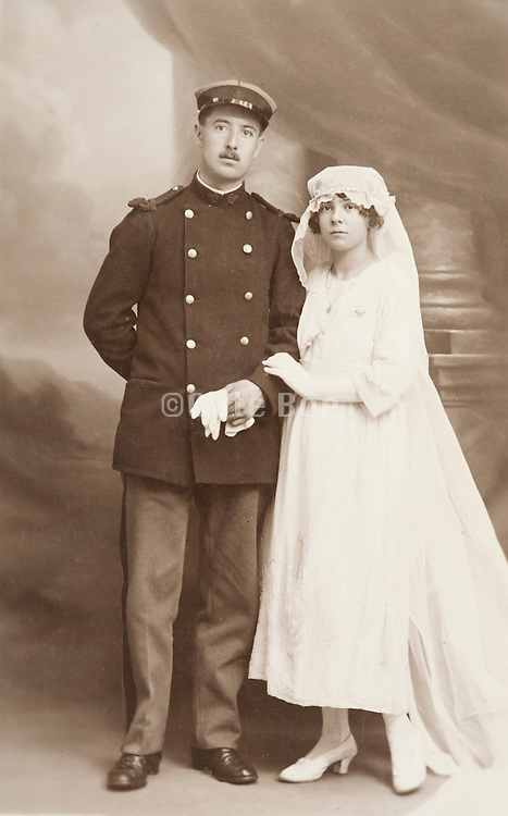 vintage wedding photograph with male person in uniform France 1920s