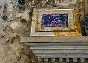 A photograph remains on a living room mantel surrounded by mold. The New Orleans house was filled with water from Hurricane Katrina.  www.kathyandersonphotography.com