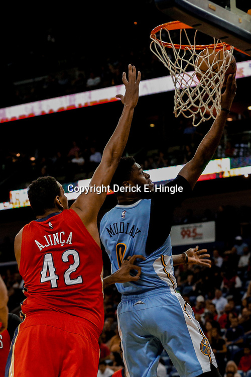 Apr 4, 2017; New Orleans, LA, USA; Denver Nuggets guard Emmanuel Mudiay (0) shoots over New Orleans Pelicans center Alexis Ajinca (42) during the first quarter of a game at the Smoothie King Center. Mandatory Credit: Derick E. Hingle-USA TODAY Sports